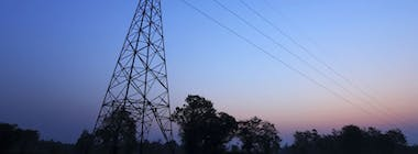 Electricity pylon and cables in night sky