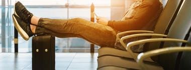 Man sat in waiting area in airport