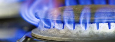 Gas ring on a hob with blue flame