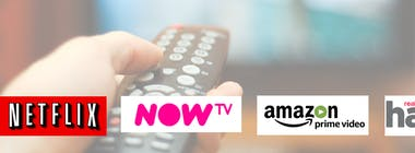 TV remote pointing at TV with Netflix NOW TV Amazon Prime Video and Hayu logos
