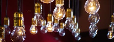 Lit light bulbs hanging from ceiling