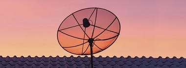 Satellite dish on top of a house to provide satellite broadband