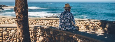 Old man on holiday overlooking the sea