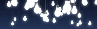 Light bulbs hanging from the ceiling in a blue room