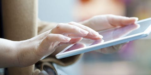 Person scrolling on an ipad tablet