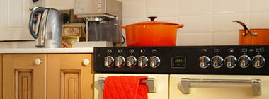 Range cooker with cooking pots on top of a gas hob