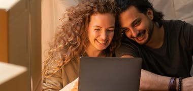 mortgages cosy couple on laptop