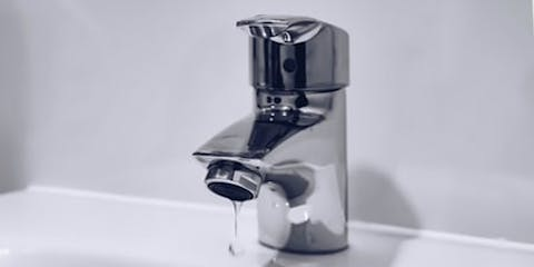 Tap dripping into a basin